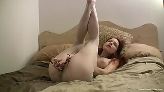 Redhead cutie rips her nylon pantyhose to pleasure her pussy