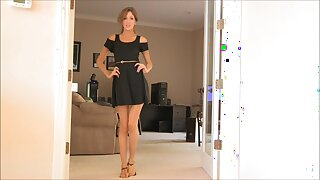 Cute trophy wife dressed in a black dress enjoys teasing. HD