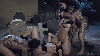 Slutty babes having an orgy in a cemetery and these ladies are so wild
