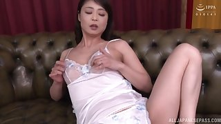 Solo Japanes girl Ootomo Izumi plays with her horny wet pussy